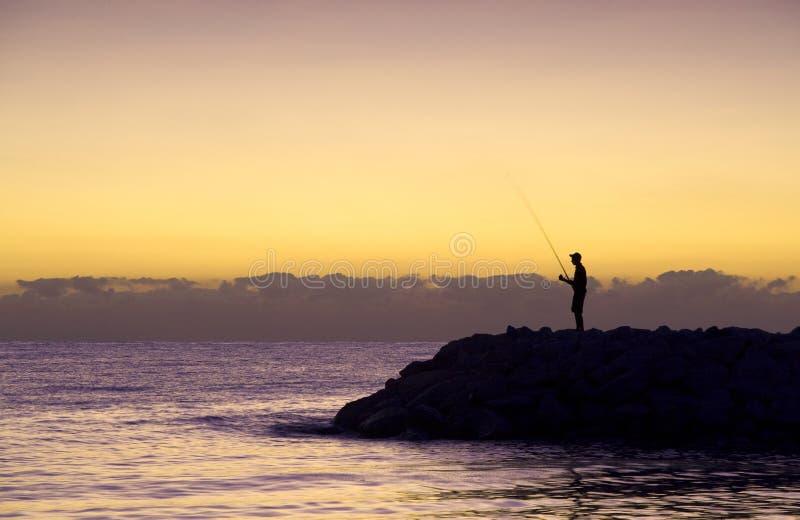 rybaka sylwetki wschód słońca fotografia stock
