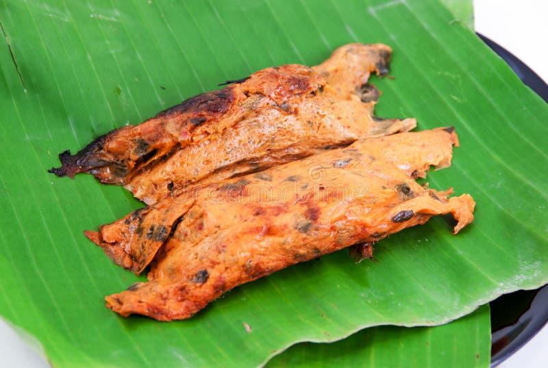 Rybi curry w bananowych liściach fotografia stock