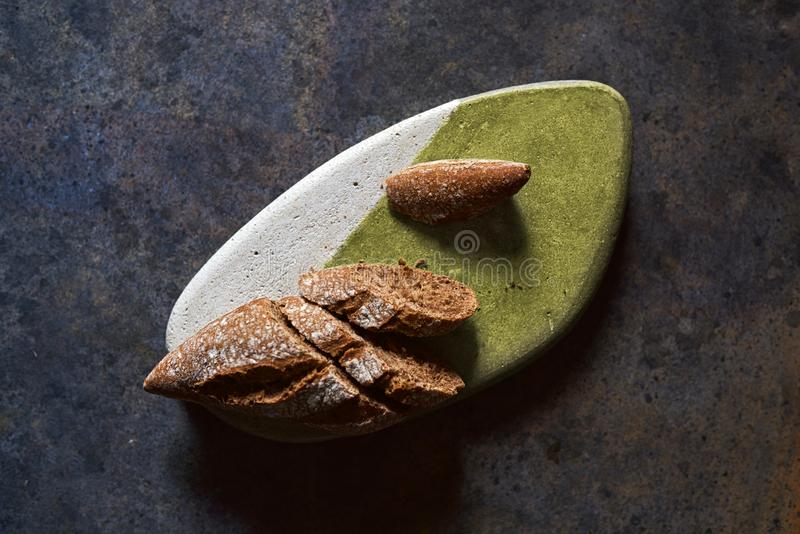 Rye bread, cut into slices. On stone table on grunge background stock images