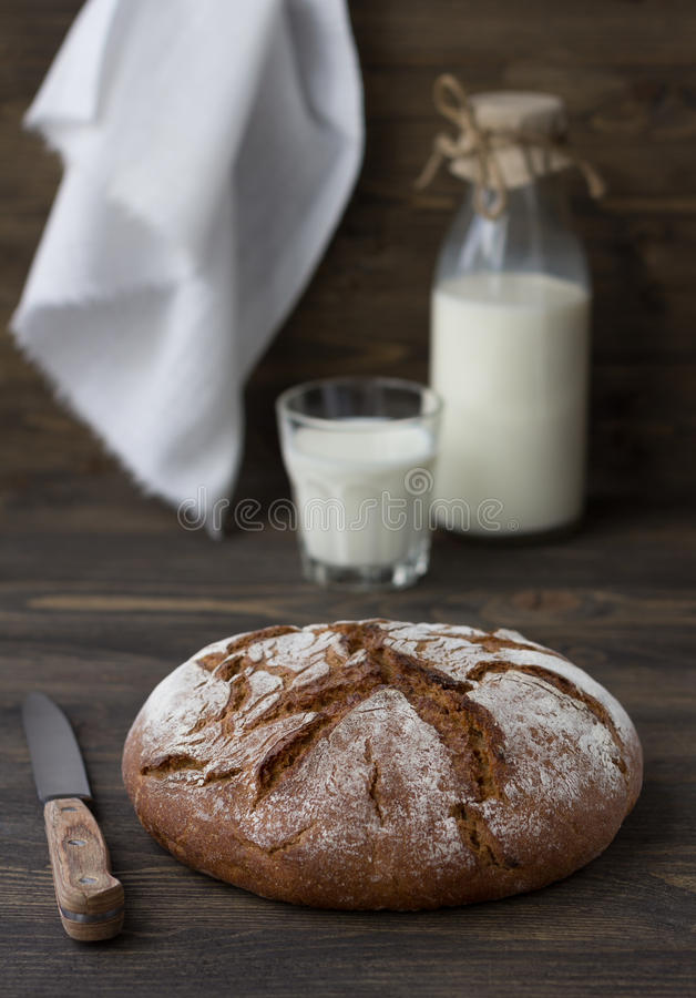 Rye bread with milk on wooden background stock image