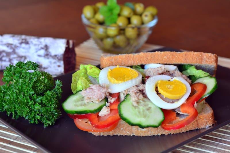 Rye bread sandwich with tuna fish, eggs, tomato and cucumber stock image