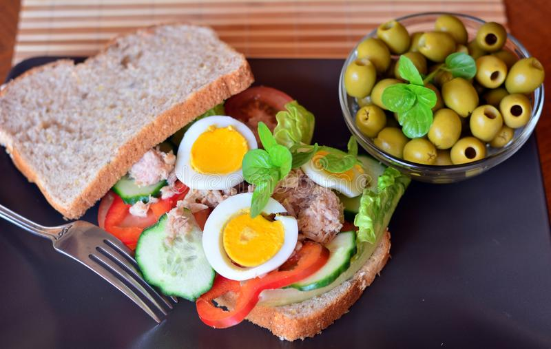 Rye bread sandwich with tuna fish, eggs, tomato and cucumber stock photos