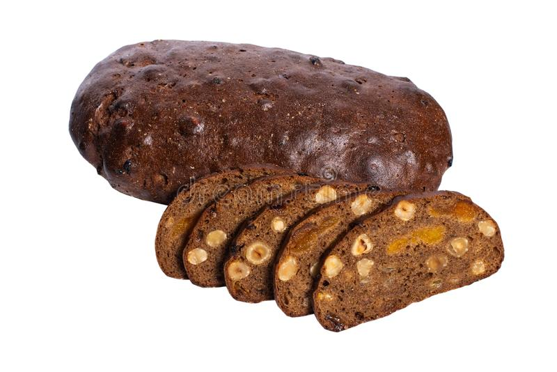 Rye bread with seeds, nuts and dried fruits, whole grain bread on a white background. Whole grain homemade bread, made in craft bakery stock images