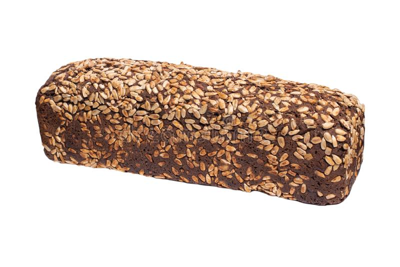 Rye bread with seeds, whole grain bread on white background. Whole grain homemade bread, made in craft bakery stock photo