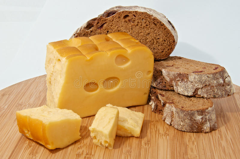 Rye bread and smoked cheese on wood board royalty free stock images