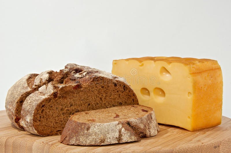 Rye bread and smoked cheese on wood board stock photos