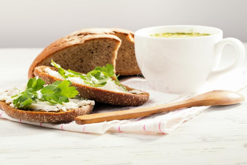 Rye bread with soft cheese and greens royalty free stock images