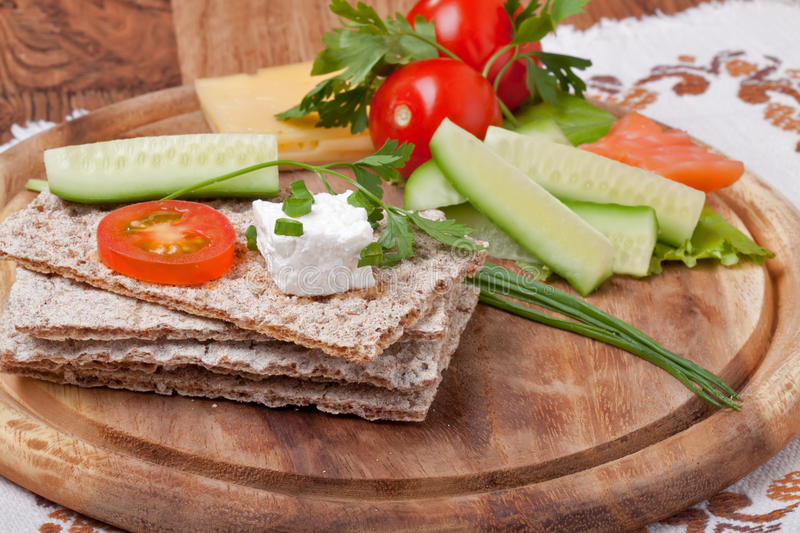 Rye Crispbread and vegetables royalty free stock photo