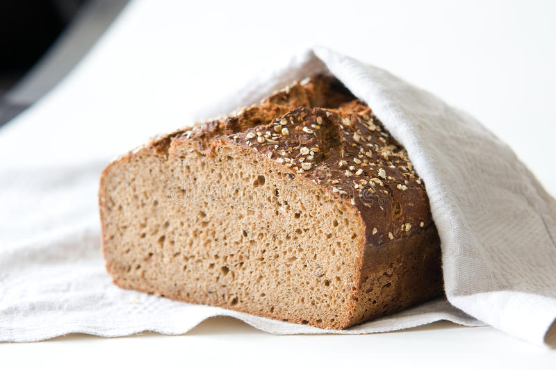 Rye sourdough bread. Covered with linen cloth, shallow DOF stock photos