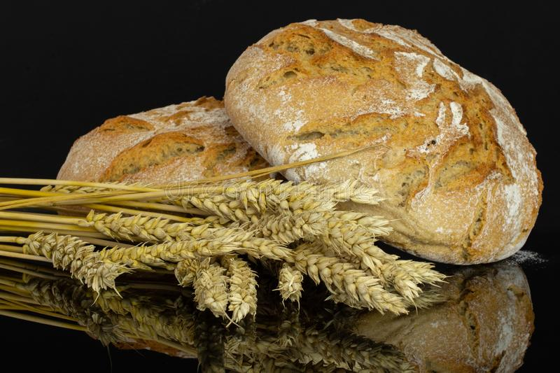 Rye wheat bread isolated on black glass royalty free stock photography