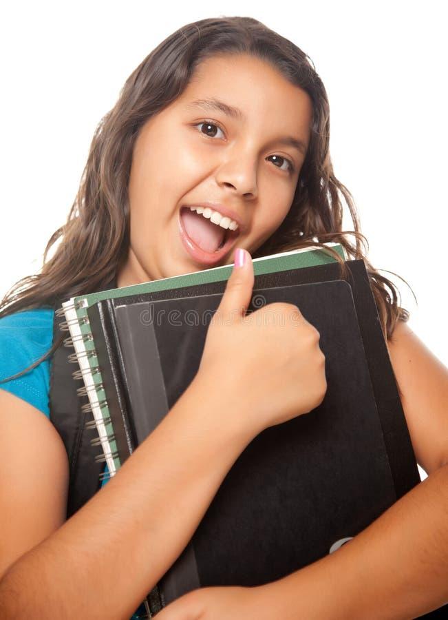 ryggsäcken books den nätt flickalatinamerikanen arkivfoto