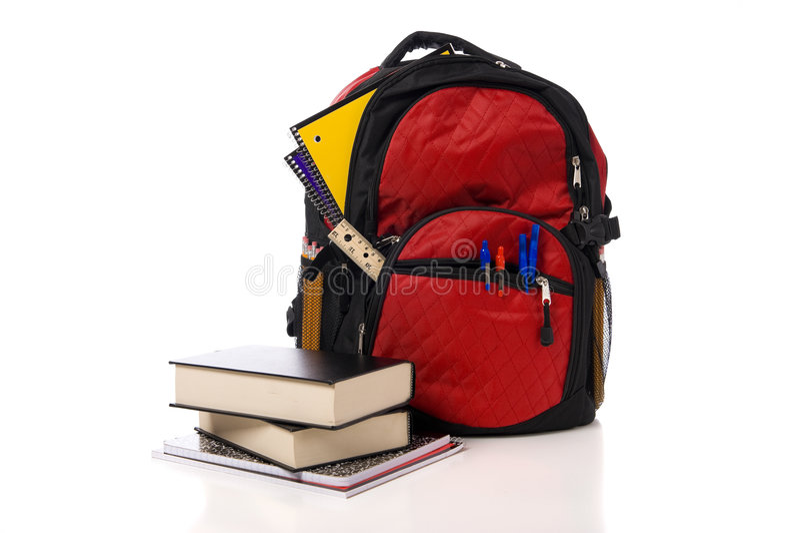 ryggsäcken books den röda skolan royaltyfri bild