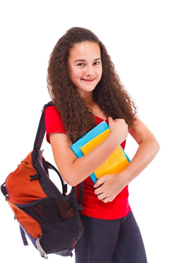 ryggsäcken books den tonårs- flickan royaltyfria bilder