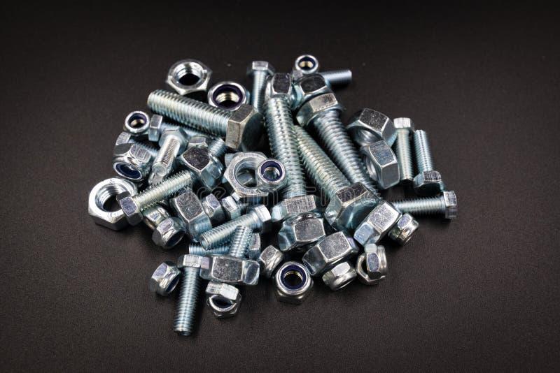 Rygle i dokrętki dla narzędzia domu przemysłu samochodowego zdjęcie stock