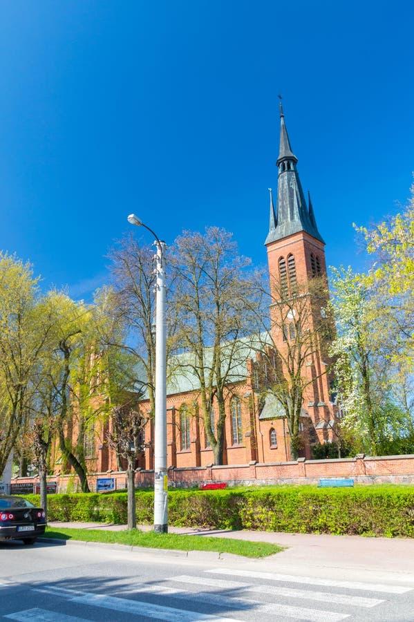 Roman Catholic parish church of the Holiest Saviour with blue sky. Ryki, Poland - April 18, 2018: Roman Catholic parish church of the Holiest Saviour with blue royalty free stock photos