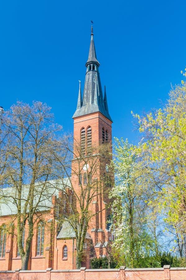 Tower of Roman Catholic parish church of the Holiest Saviour. Ryki, Poland - April 18, 2018: Tower of Roman Catholic parish church of the Holiest Saviour stock photos