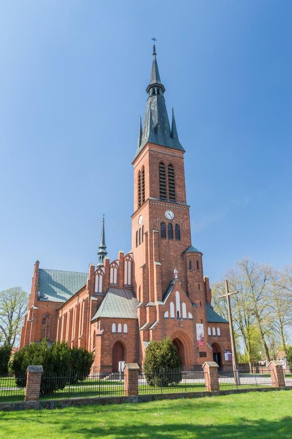 Tower of Roman Catholic parish church of the Holiest Saviour. Ryki, Poland - April 18, 2018: Tower of Roman Catholic parish church of the Holiest Saviour royalty free stock image