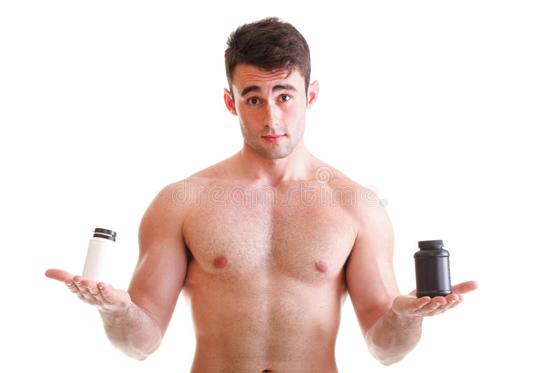 Rymma askar med supplements på hans biceps royaltyfri fotografi