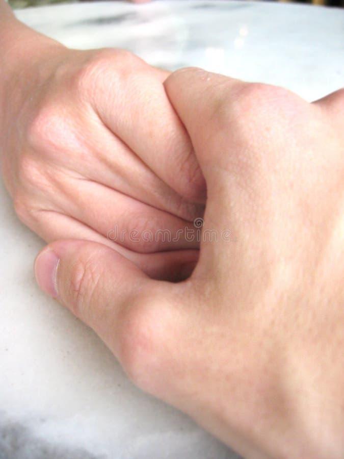 rymma för händer arkivfoton