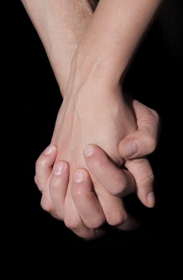 Rymma två händer tillsammans Union- och förälskelsebegrepp royaltyfria foton