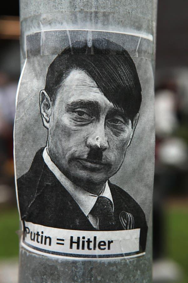 Rysk president Vladimir Putin som visas som Adolf Hitler royaltyfria bilder