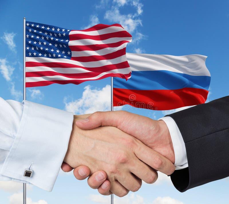 Ryss och USA handskakning royaltyfria bilder