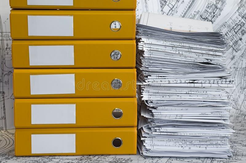 rysunków skoroszytowy rozsypiska projekta kolor żółty zdjęcia stock