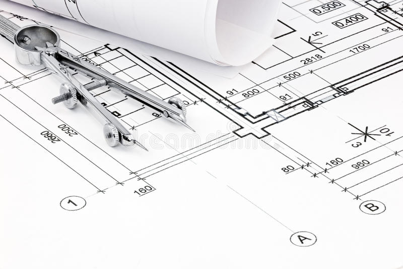 Rysunkowy kompas na domowym planu projekta zbliżeniu zdjęcia royalty free