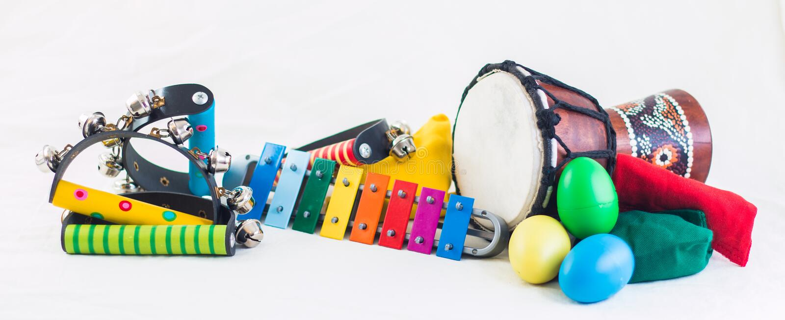Rythm instruments. Kids musical instrument in many colors isolated on white background royalty free stock photo