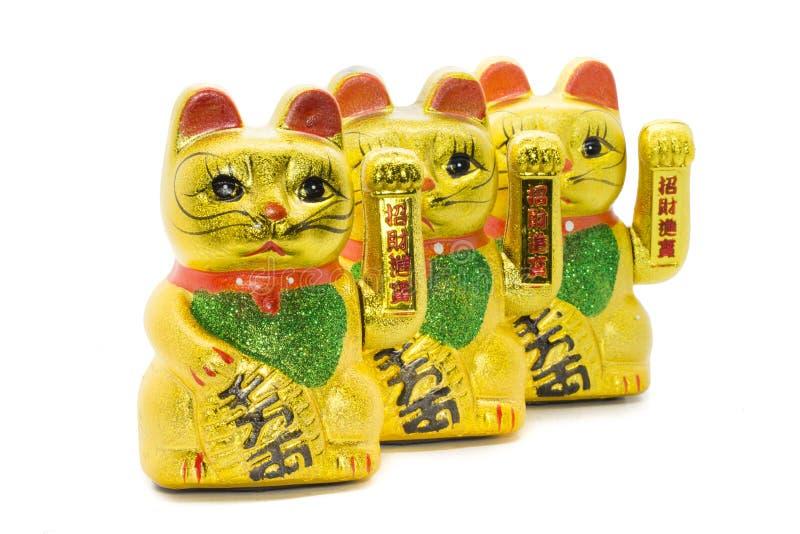Rząd Maneki neko falowania szczęsliwy azjatykci kot zdjęcie royalty free