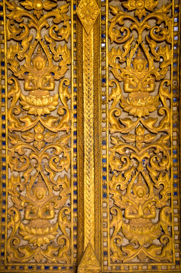 Rzeźba drzwiowy Wat Phra Keo w Vientiane Ho zdjęcia royalty free