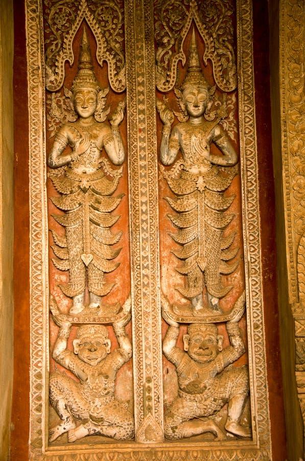 Rzeźba drzwiowy Wat Phra Keo w Vientiane Ho zdjęcie royalty free