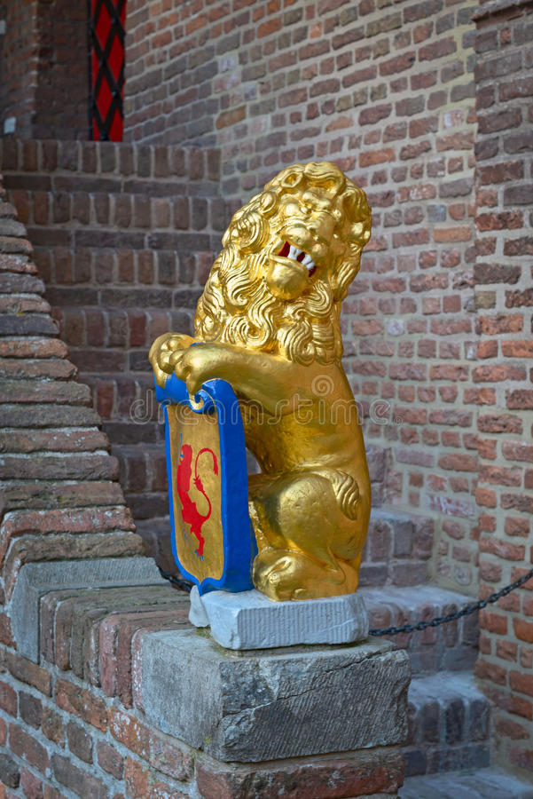 Rzeźba: lwa mienia osłona z żakietem ręki obraz stock