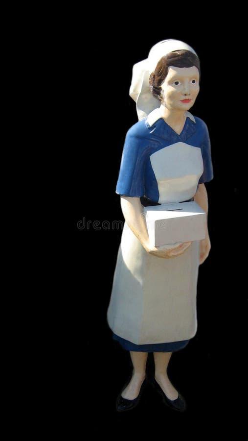 Rzeźba pielęgniarki przewożenia darowizny dobroczynności pudełko obraz royalty free