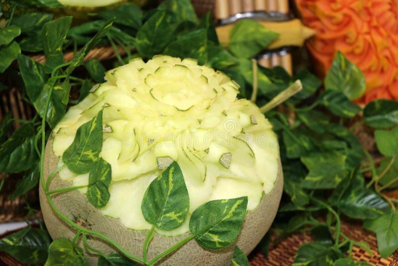 Rzeźbiąca owoc kantalup kwitnąć formę fotografia royalty free