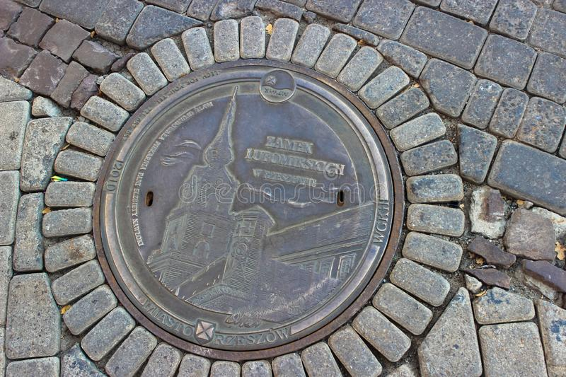 Rzeszow, Poland - A magnificent sewage hatch with a castle pattern stock image