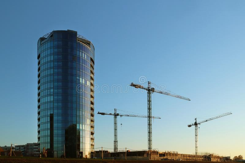 Rzeszow, Poland - oct 9 2018: Construction of an office skyscraper in the rays of an evening sunset. Modern architecture in urbani royalty free stock photo