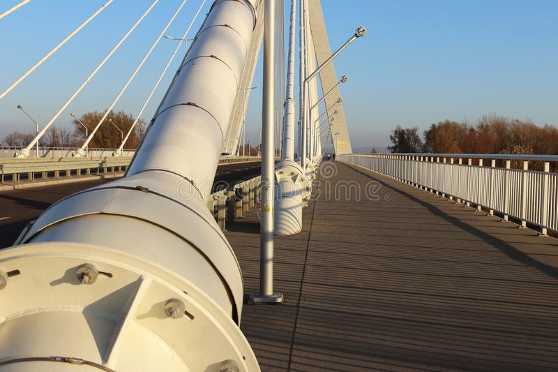 Rzeszow, Poland - 9 9 2018: Suspended road bridge across the Wislok River. Metal construction technological structure. Modern arch stock photography