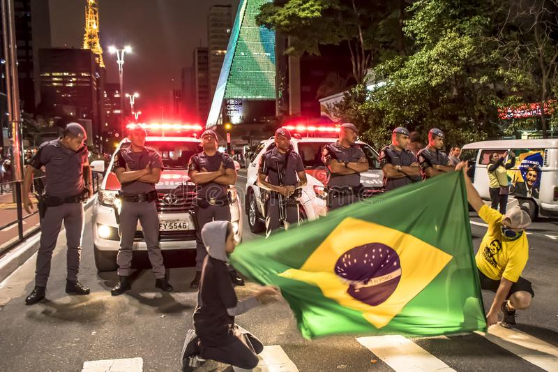 Supporters celebrate Bolsonaro victory in São Paulo - Supporters of President-elect Jair Bolsonaro celebrate the candidate`s vict. São Paulo, Brazil royalty free stock photos