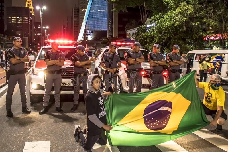 Supporters celebrate Bolsonaro victory in São Paulo - Supporters of President-elect Jair Bolsonaro celebrate the candidate`s vict. São Paulo, Brazil royalty free stock photo