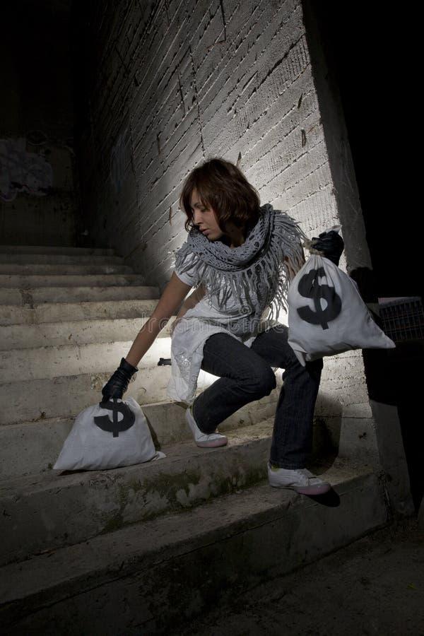 säck för rånare för grupppengar arkivfoto