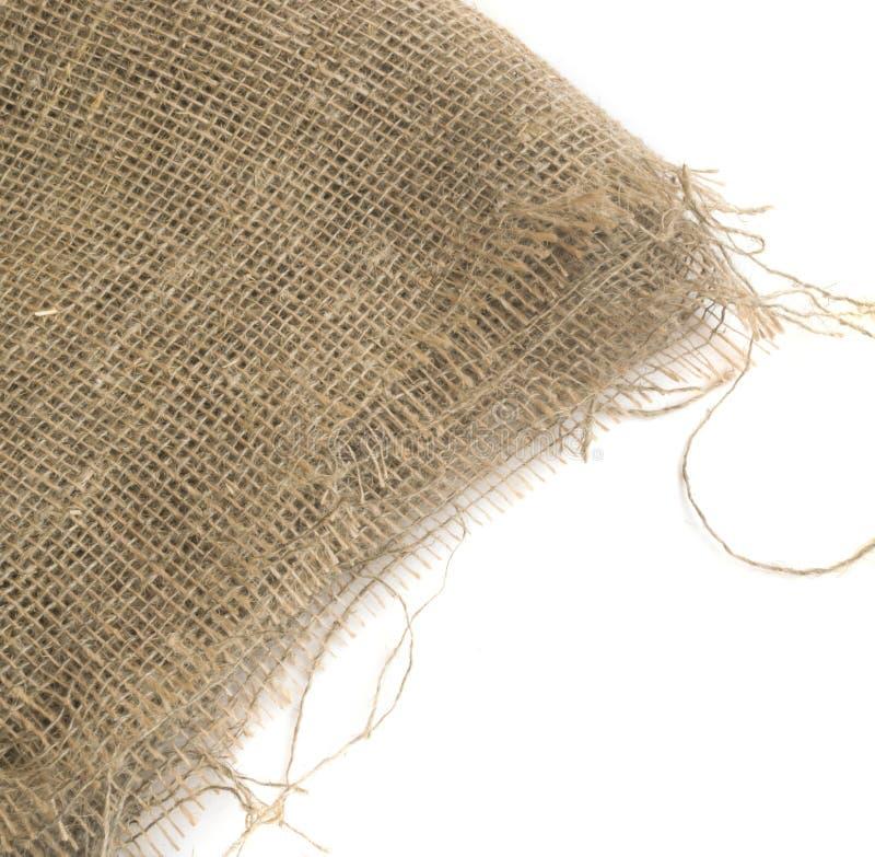 Säckvävkant eller gammal linnekanfas på vit bakgrund royaltyfri bild