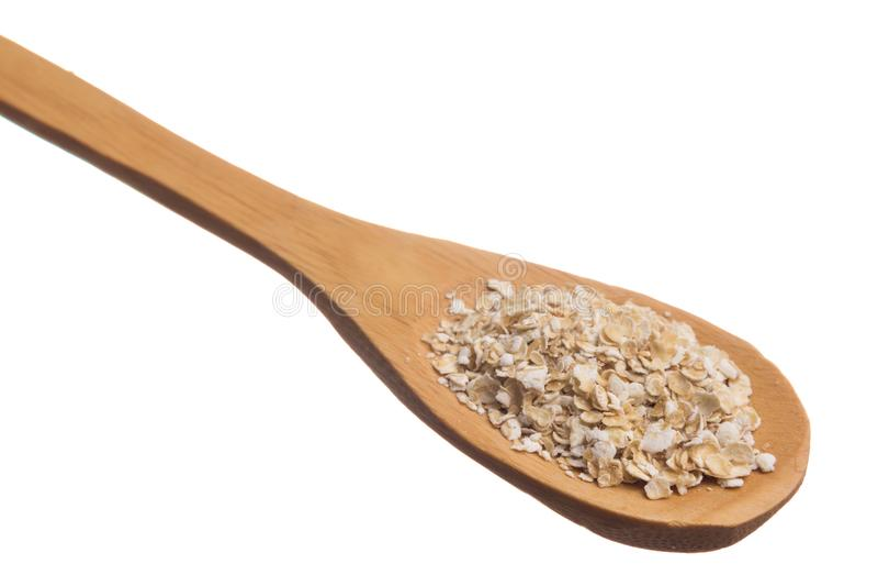 Sädes- korn för havre Korn över träskeden, isolerad vit bakgrund royaltyfri bild