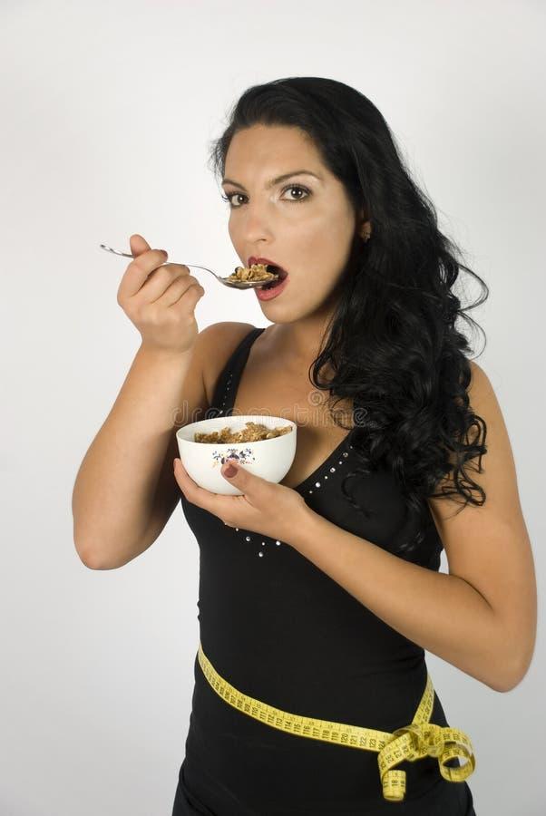 sädesslag som äter kvinnan royaltyfria foton