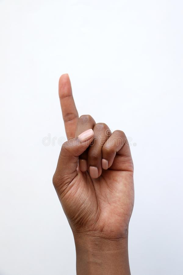 Säennummer eins des Schwarzafrikaners indisches Hand, aufwärts zeigend stockfotografie