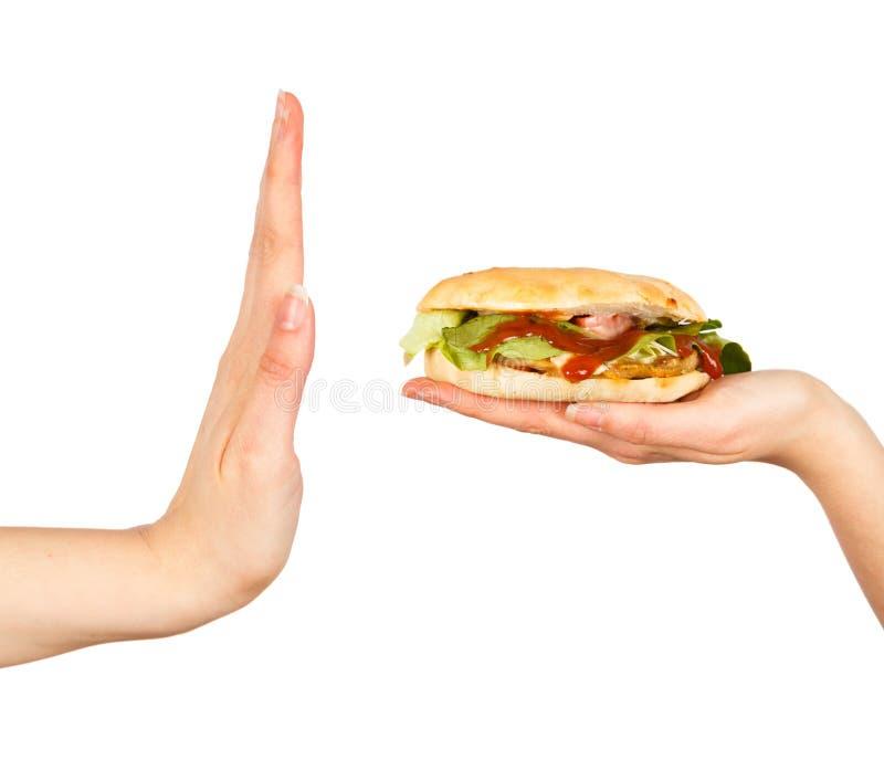 Säg inte till sjuklig mat! arkivfoto