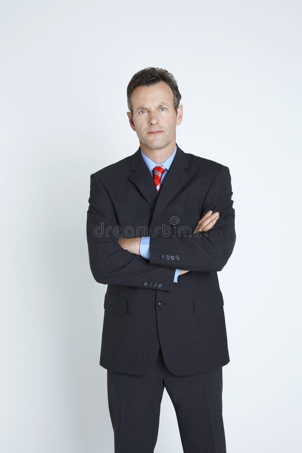 Säker affärsman With Hands Folded arkivbild