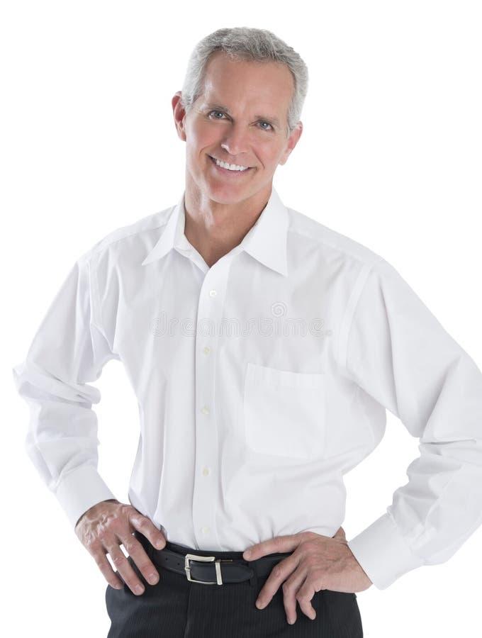 Säker affärsmanStanding Over White bakgrund royaltyfri foto