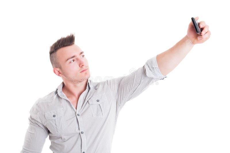 Säker man eller man som tar en selfie arkivbild