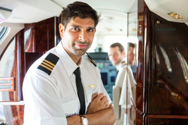 Säker pilot In Private Jet royaltyfri foto